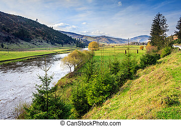 autumn landscape with river at mountain foot - fields and...