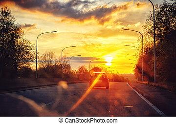 Autumn landscape with sunset road