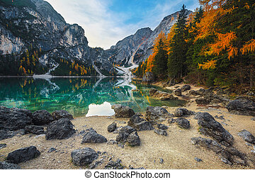 Autumn landscape with turquoise mountain lake in Dolomites, Italy