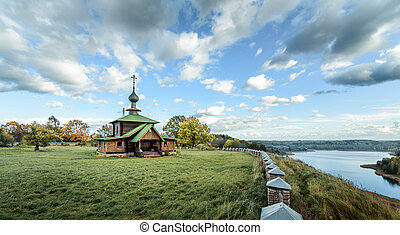 autumn landscape with view of the Church and lake before the rain