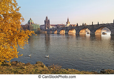 autumn landscape with views of the Charles Bridge in Prague