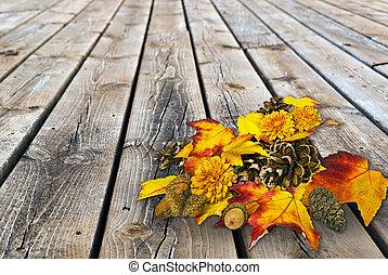 autumn leaf bouquet on rustic wood