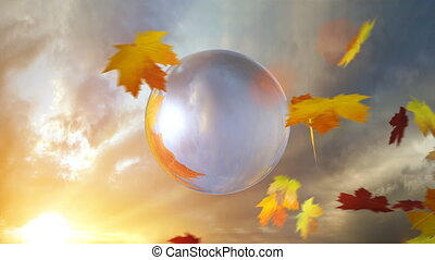 An autumn scene with a glass globe reflecting seasonal weather typically associated with autumn with falling leaves with a dramatic background.