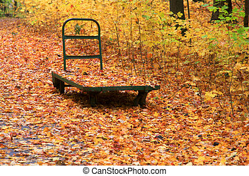 Autumn leaves and cart