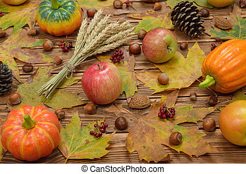 Autumn leaves, apples, pumpkins and nuts