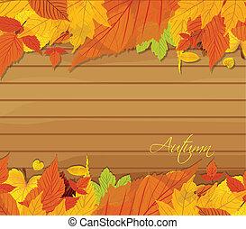 Autumn leaves background on wood