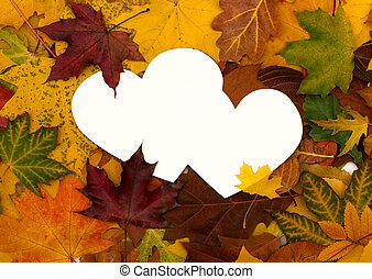 Autumn leaves background with empty greeting card for text