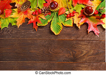 autumn leaves border on wooden background - colorful autumn...