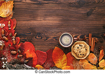 autumn leaves, cookies and tea on wooden background