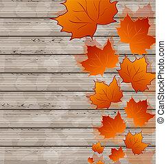Autumn leaves maple on wooden texture