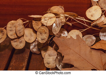 Autumn leaves on a wooden table