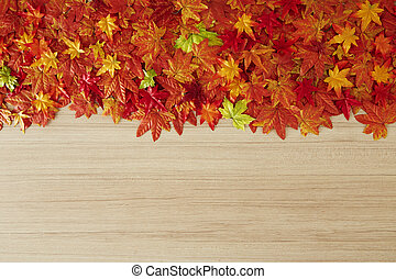 Autumn leaves on a wooden table - Top view maple leaves ...