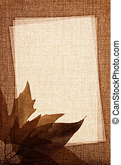 Autumn leaves on fabric texture with copy space