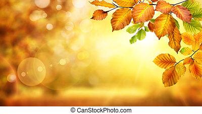 Autumn leaves on shimmering bokeh background