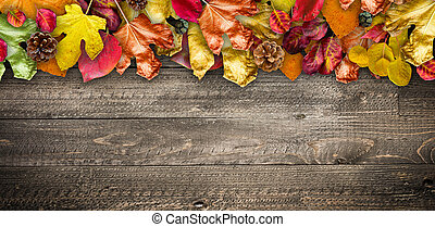 Autumn Leaves over a Natural Dark Wooden background. Old ...