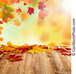 Autumn leaves - Colored autumn leaves on wooden planks