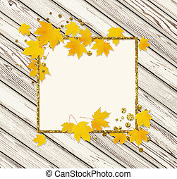 Autumn maple twig with yellow leaves and a golden glitter frame on white wooden background. Flat lay. Top view.