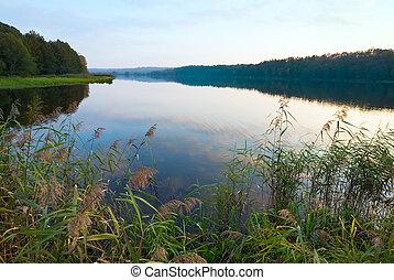 Autumn misty evening lake