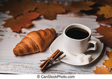 Autumn morning Breakfast with a Cup of coffee and a croissant
