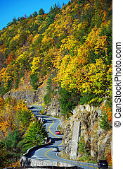 Autumn mountain with winding road