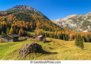 Autumn mountains rural scene. Hiking in Austrian Alps, Tyrol, Austria.