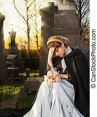 Autumn mourning - Young Victorian widow mourning on a...