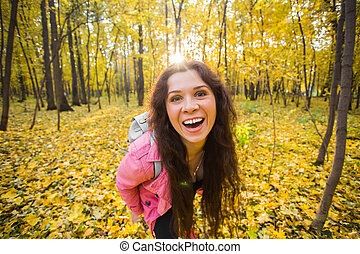 Autumn, nature and people concept - Close up portrait of funny woman in park