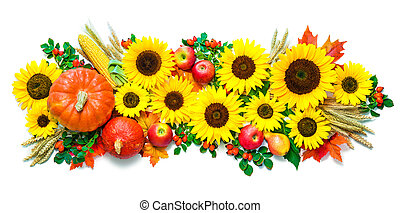 Autumn or Thanksgiving background with sunflowers, pumpkins, apples, wheat and rose hips