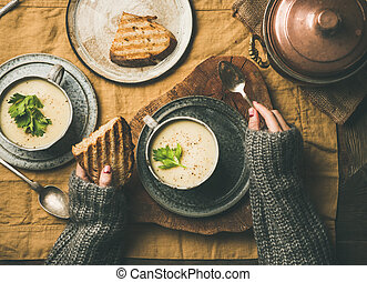 Autumn or winter home dinner with celery cream soup