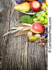 Autumn organic fruit on rustic wooden table