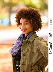 Autumn outdoor portrait of beautiful African American young woman - Black people