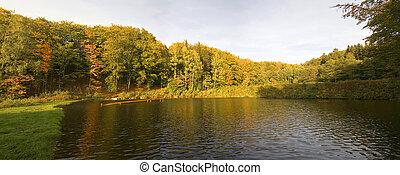 autumn panorama - panorama of autumn trees behind a pond