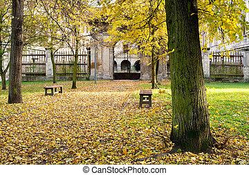 Autumn park with a historic building