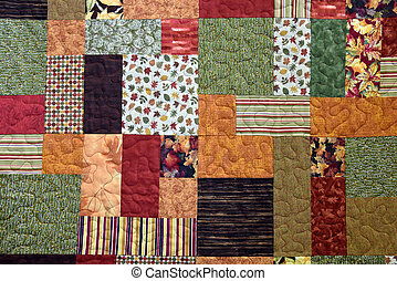 Autumn patchwork quilt with calico fabric.