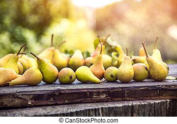 Autumn pears on wood
