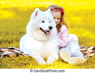 Autumn photo dog and child having fun outdoors