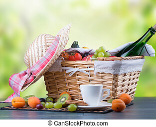picnic - Autumn picnic on wooden table with a basket of food