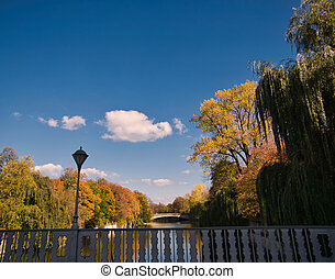 Autumn picture of a bridge at the Isar in Munich