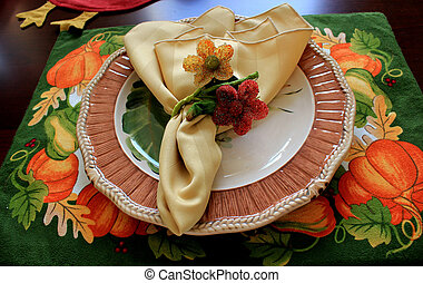 Autumn placesetting - A table set with an Autumn seasonal...