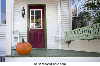 Autumn porch - Country home porch with pumpkin and swing