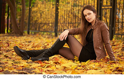 Autumn portrait of a beautiful woman in the park
