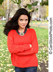 Autumn portrait of a girl in a red sweater