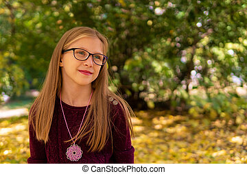 autumn portrait of a girl with glasses