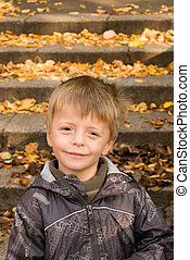 Autumn Portrait of a happy five year old child.