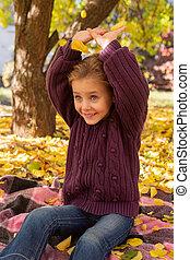 autumn portrait of a joyful child