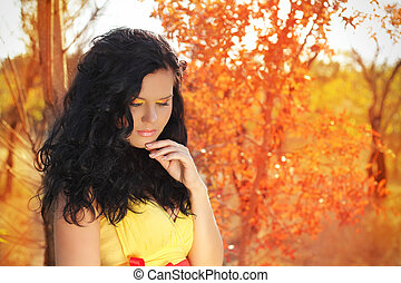 Autumn portrait of beautiful brunette woman model with bright makeup