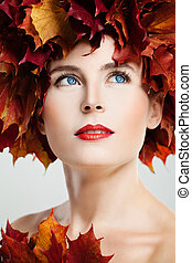 Autumn Portrait of Beautiful Woman with Red Fall Maple Leaves Wreath and Perfect Makeup