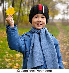 Autumn portrait of cute child