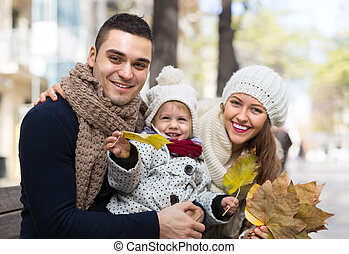 Autumn portrait of parents with children