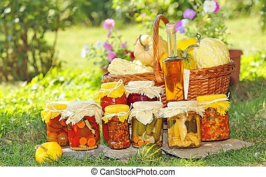 autumn preserves - Vegetable preserves placed on the grass...